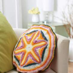 Starburst circle crochet cushion