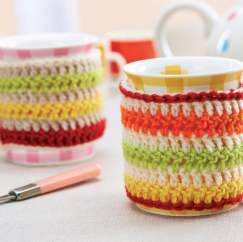 Striped crochet mug cosies