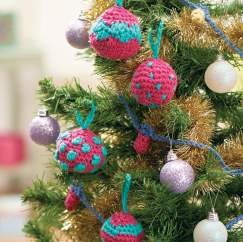 Crochet baubles and fairy lights garland