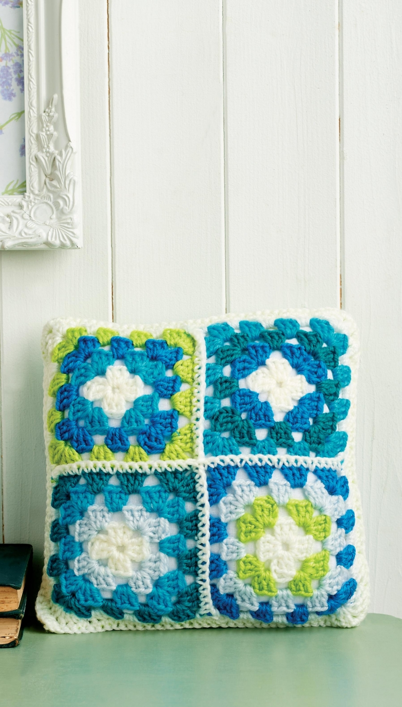 Crochet cushion with four mini granny squares