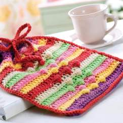 Crochet hot water bottle cosy