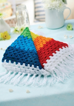 Stripy crochet rainbow blanket
