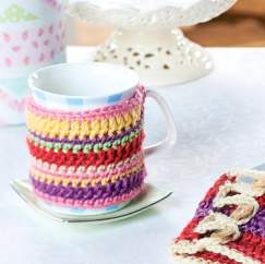 Cheerful crochet teacosy, mug cosy and coasters